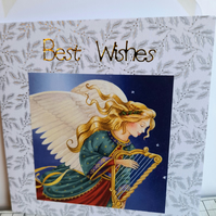 Christmas card showing angel with harp