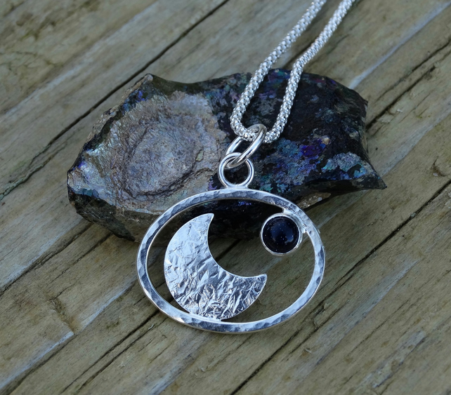 Textured crescent moon pebble pendant in Eco Silver with blue goldstone