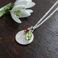 Textured recycled Eco Silver disc pendant with peridot and garnet