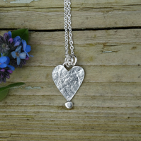 Tiny recycled silver heart pendant