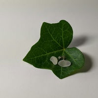 Silver ear studs with clear sea glass