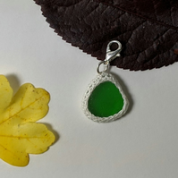 Green sea glass charm or pendant with crochet details