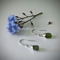Silver earrings with moss green sea glass