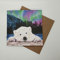 Polar bear cub Christmas greeting card . Northern Lights Xmas card . Love bears