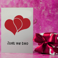 Two red hearts greetings card . Engagement card .  Anniversary card