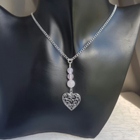 Gorgeous Rose Quartz Beads and Heart of Heart charm Necklace.