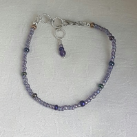 Pretty Purple Small Bead Bracelet.