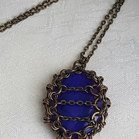 Gorgeous Caged Fire Purple Pendant Necklace.