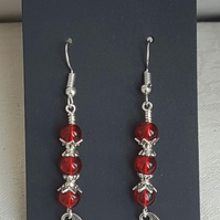 Vampire Bat Earrings - Silver tones and red beads.