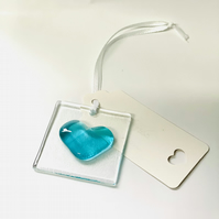 A gift card and a beautiful fused glass heart hanging decoration