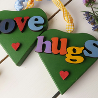 Pair of Wooden Hanging Hearts Love and Hugs