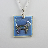 Dog on leather pendent