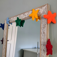Hand-knitted rainbow stars
