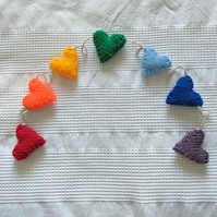 Hand-knitted rainbow hearts