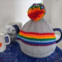 Rainbow stripe knitted tea cosy