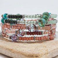 Pink, red, teal green and silver wrap bracelet