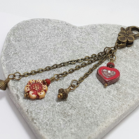 Floral boho heart bag - key charm in red and bronze