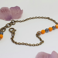 Dainty Czech glass bracelet in bright orange and deep blue