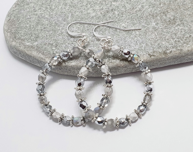Sparkly silver hoop style earrings