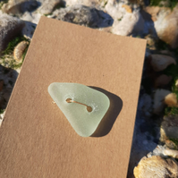 Large triangular very pale green sea glass button