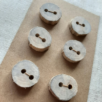 Set of six small flat driftwood buttons