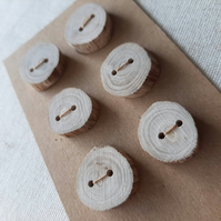 A set of six pale flat driftwood buttons