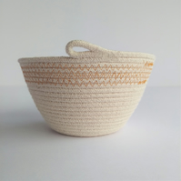 Freshwater Bowl, a coiled rope bowl with ochre stitched detail
