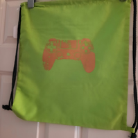 Bright green drawstring bag with game control image
