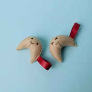Two happy, felt fortune cookies