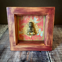 Miniature Buddha & Collaged Background in a box frame.