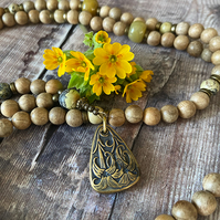 Floral Pendant Mala Made with Matrix Turquoise