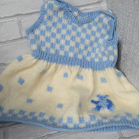 Knitted baby pinafore dress with teddy bear detail