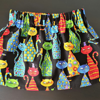 Baby's skirt with fun multicoloured cat print