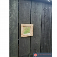 Pretty little medieval square stud mirror