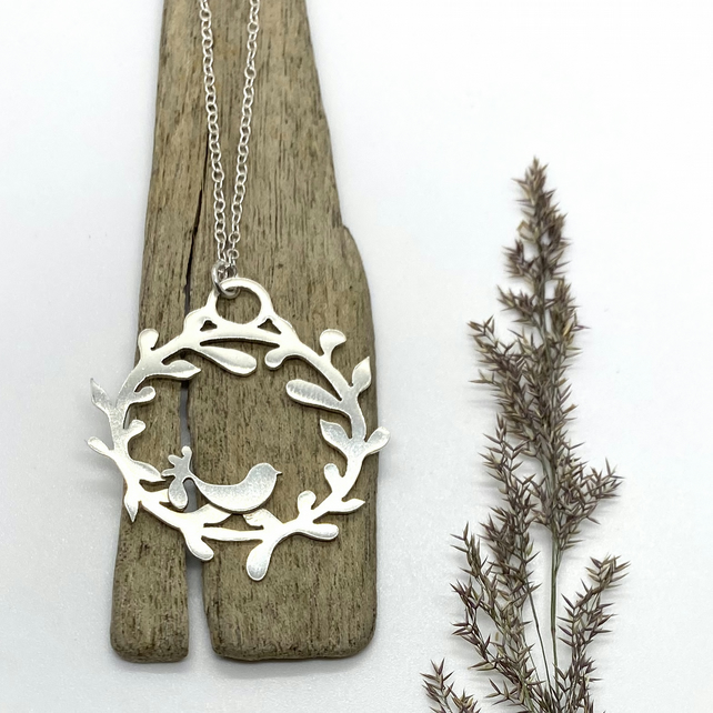 Bird and wreath silver pendant necklace