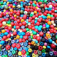 A Mix of Coloured Wooden Beads with free Elastic