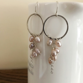 Sterling silver hoop earrings with a pink freshwater pearl cluster