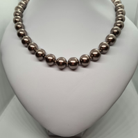 Faux pearl knotted necklace         040