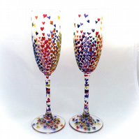 Two rainbow champagne glasses, hand painted rainbow glasses
