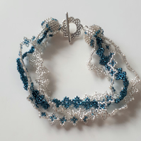 Pretty multi-strand, silver and turquoise beaded bracelet
