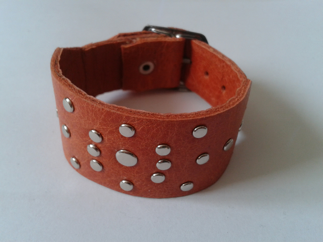 orange leather adjustable wristband with rivet design