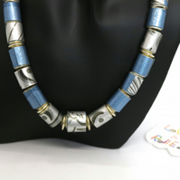 Metallic blue and patterned grey paper beaded necklace on a silver plated chain