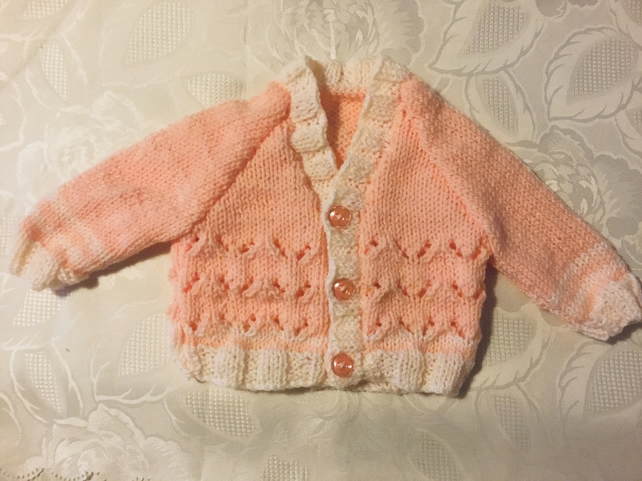 Hand knitted Baby girls cardigan in a peach yarn 0-3 Months