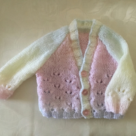 Hand knitted Baby girls cardigan in a pink, yellow and blue rainbow yarn 3 Month