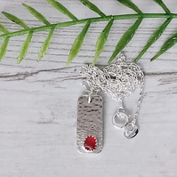 Sterling silver and red sea glass pendant necklace.