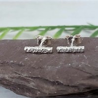 Mini sterling silver bar earrings.