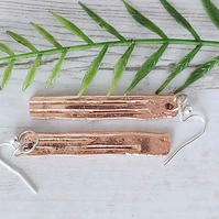 Copper drop earrings.