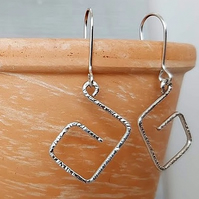 Sterling silver square earrings.