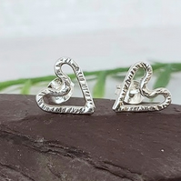 Small sterling silver heart stud earrings.