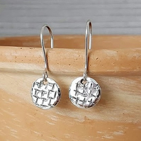 Sterling silver disc earrings.